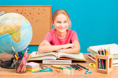 Smiling girl doing her homework Stock Photography