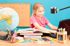 Smiling girl doing her homework Royalty Free Stock Photo