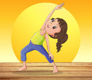 A smiling girl doing yoga Royalty Free Stock Image