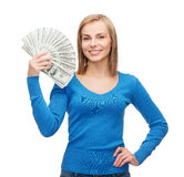 Smiling girl with dollar cash money Royalty Free Stock Images