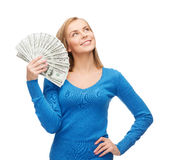 Smiling girl with dollar cash money Royalty Free Stock Photography