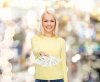 Smiling girl with dollar cash money Stock Image