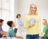 Smiling girl with dollar cash money Stock Images