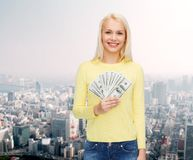 Smiling girl with dollar cash money Stock Photos