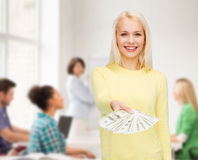 Smiling girl with dollar cash money Stock Photos