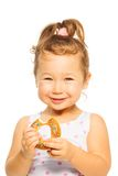 Smiling girl with donut Stock Photography