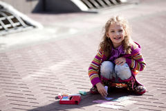 Smiling girl draw at the street Royalty Free Stock Photography