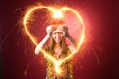 Smiling girl drawing heart Stock Photos
