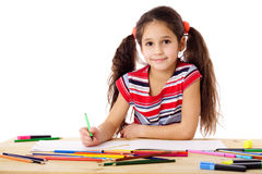 Smiling girl drawing in the notebook Royalty Free Stock Photography