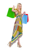 Smiling girl in dress with shopping bags Royalty Free Stock Images