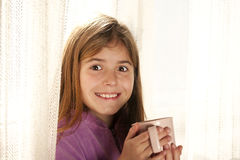 Smiling girl drinking tea Royalty Free Stock Photo