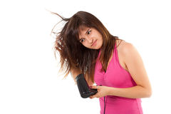Smiling girl drying her hair Stock Photography