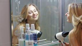 Smiling girl drying her hair stock video