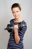 Smiling girl with dumbbell Royalty Free Stock Photos