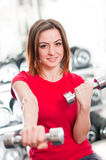 Smiling girl with dumbbells Stock Photo