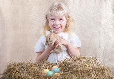 Smiling girl with Easter bunny Stock Photography