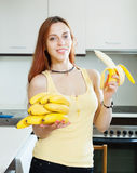 Smiling girl eating banana Royalty Free Stock Image