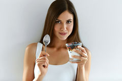 Smiling Girl Eating Healthy Organic Yogurt With Berries And Oats Stock Images