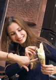 Smiling girl eating ice cream. In town Royalty Free Stock Images