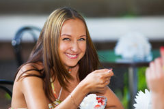 Smiling girl eating ice scream Royalty Free Stock Photo