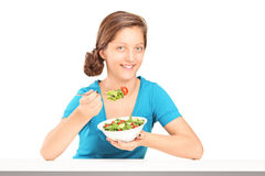 A smiling girl eating salad Royalty Free Stock Photography