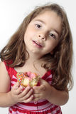 Smiling girl eating snack Stock Images