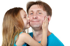 Smiling girl embrace her father. Royalty Free Stock Images