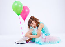 Smiling girl embracing knees Stock Photo
