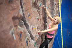 Smiling girl engaged in climbing Royalty Free Stock Photography