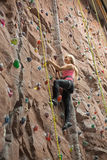 Smiling girl engaged in climbing Royalty Free Stock Photo