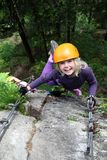 Smiling girl enjoy climbing Stock Photos