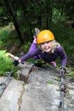 Smiling girl enjoy climbing Stock Photos