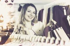 Smiling girl is enjoying her purchases Stock Image