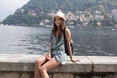 Smiling girl enjoying lake view Royalty Free Stock Photo