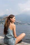 Smiling girl enjoying lake view Stock Photography