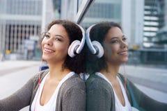 Smiling girl enjoying music on headphones Royalty Free Stock Photo