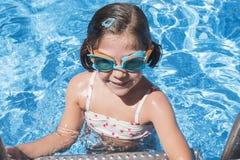 Smiling girl enjoying the pool in summer Stock Photos