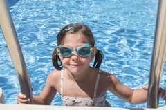 Smiling girl enjoying the pool in summer Stock Photo