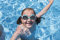 Smiling girl enjoying the pool in summer Stock Photography
