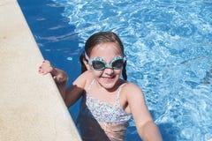 Smiling girl enjoying the pool in summer Royalty Free Stock Photos