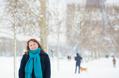 Smiling girl enjoying rare snowy day in Paris Royalty Free Stock Photography