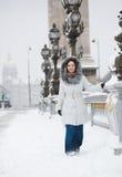 Smiling girl enjoying rare snowy day in Paris Royalty Free Stock Image