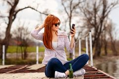 Girl enjoying and relaxing out in nature and taking selfie by th stock photo
