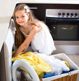 Smiling  girl enjoying the smell of washed clothes Royalty Free Stock Photo