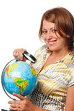 Smiling girl examines the globe Royalty Free Stock Photography