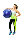Smiling girl exercising with fitness ball Royalty Free Stock Photography