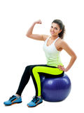 Smiling girl exercising with fitness ball Stock Images