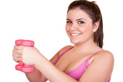 Smiling girl exercising with weights Stock Photography
