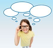Smiling girl in eyeglasses with blank text bubbles Stock Image