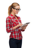 Smiling girl in eyeglasses with tablet pc computer Royalty Free Stock Photography